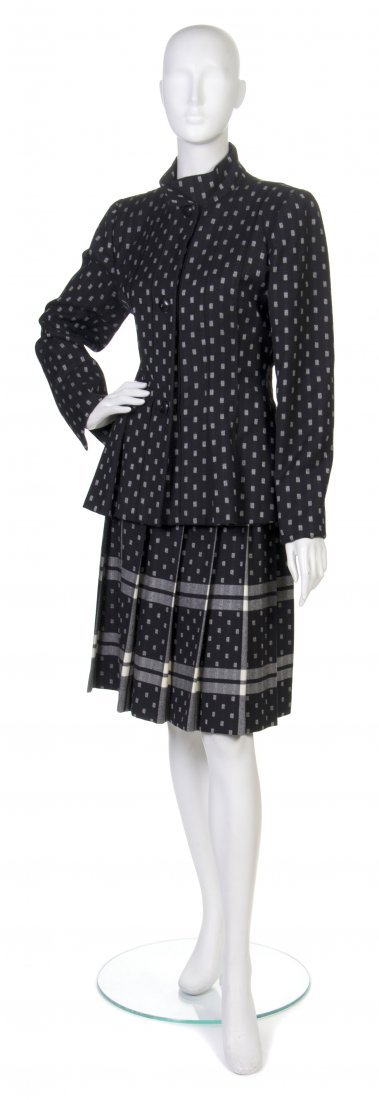 8: A Pauline Trigere Black and Cream Wool Skirt Suit.