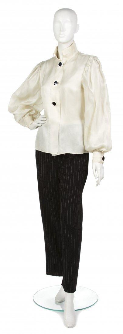 21: A Pauline Trigere Black and Cream Pant Suit,