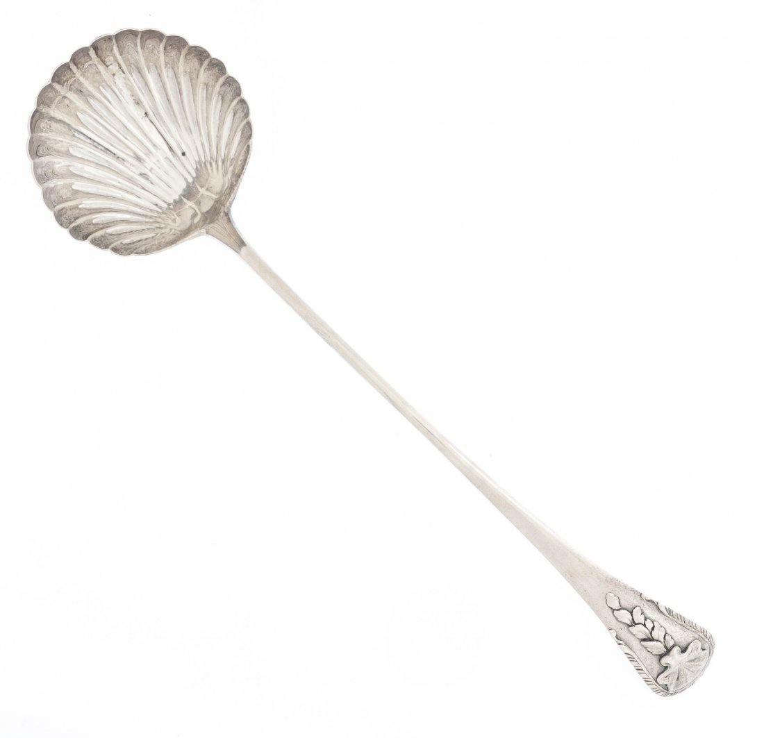 13: A George III Silver Ladle, Length 14 1/2 inches.