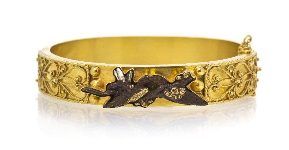 1: A 15 Karat Yellow Gold and Shakudo Bangle Bracelet,