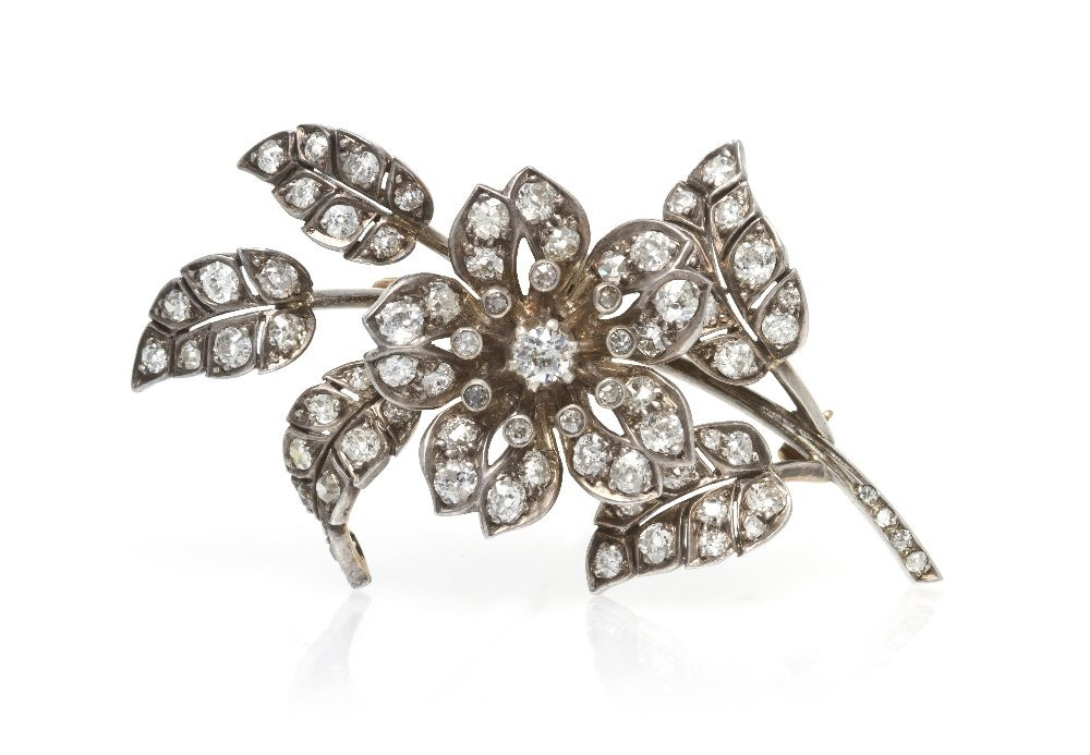 3: A Victorian Silver Topped Gold and Diamond Flower En