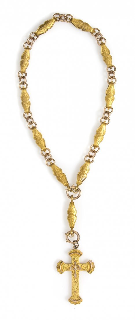 9: A Victorian Gold Cross Necklace, 45.10 dwts.