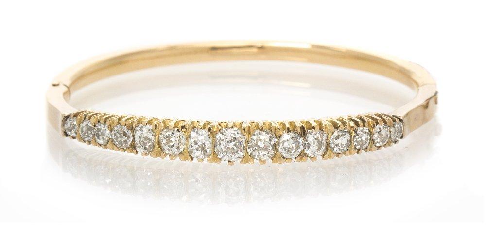 10: An Antique Yellow Gold and Diamond Bangle Bracelet,