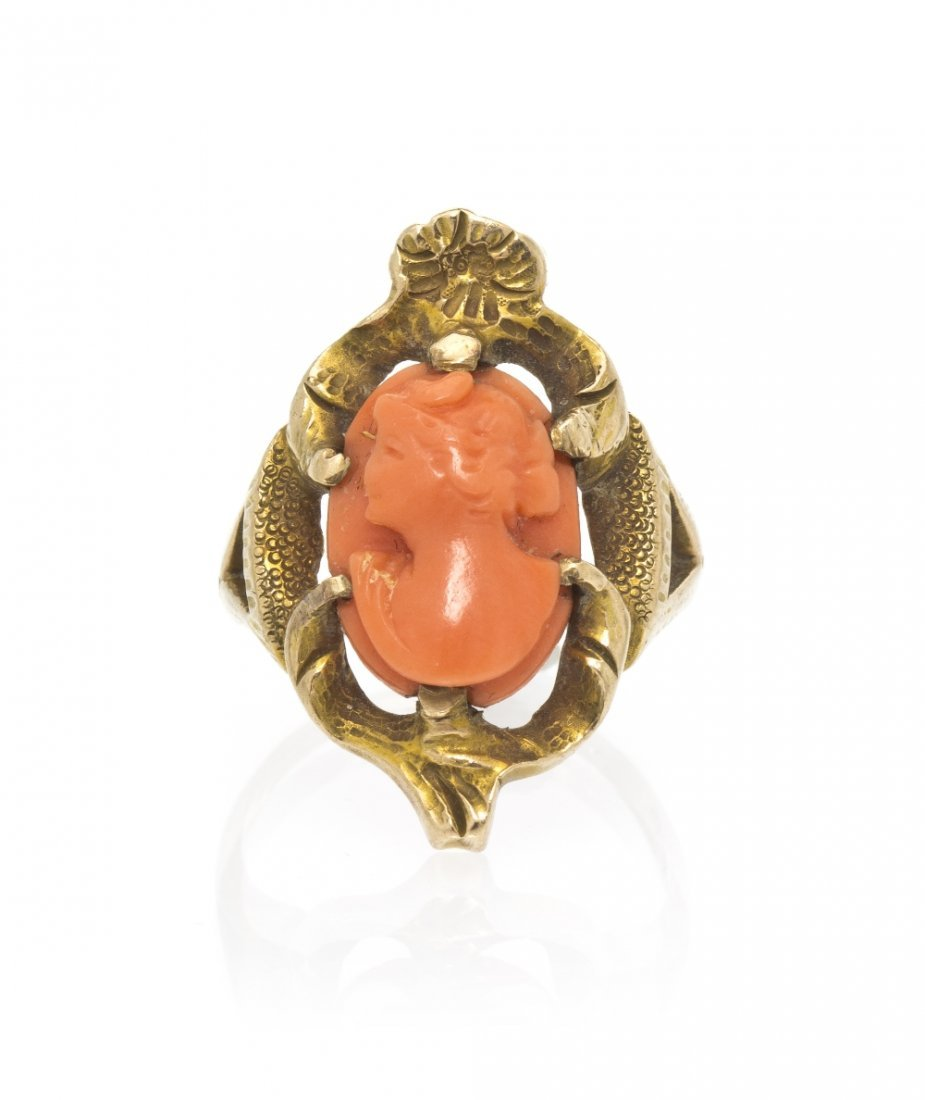 21: An Antique 14 Karat Yellow Gold and Coral Cameo Rin