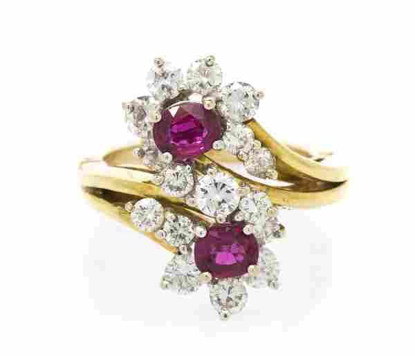 An 18 Karat Gold, Ruby and Diamond Ring. 5.40 dwts