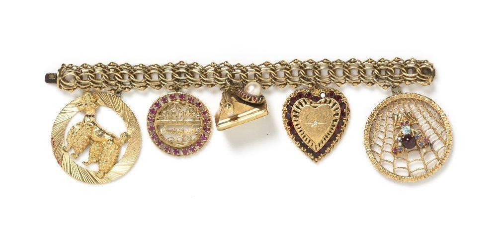 665: A 14 Karat Yellow Gold and Multi Gem Charm Bracele