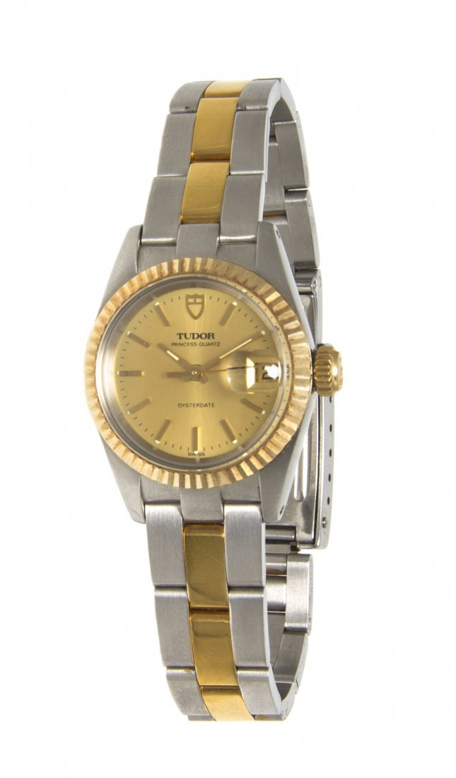 23: A Stainless Steel and 14 Karat Yellow Gold Wristwat