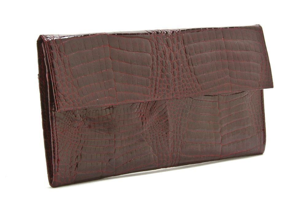 539: A Burgundy Alligator Wallet, 6 3/4 x 3 1/2 inches.