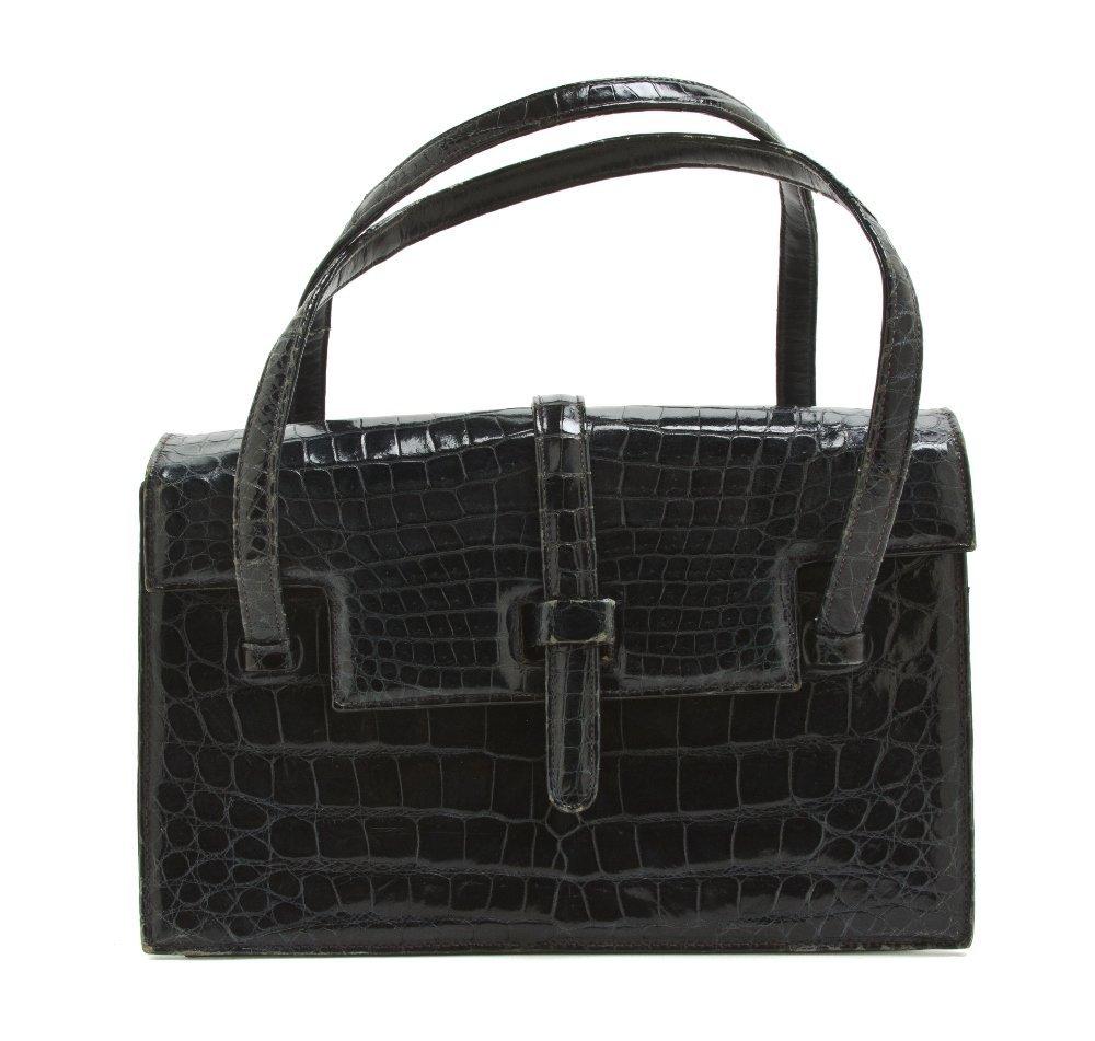 543: A Lucille Navy Crocodile Bag, 9 x 6 x 3 inches.