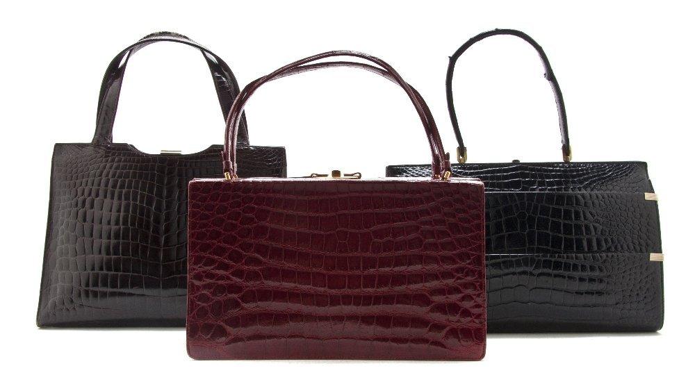 544: A Group of Three Crocodile Bags,