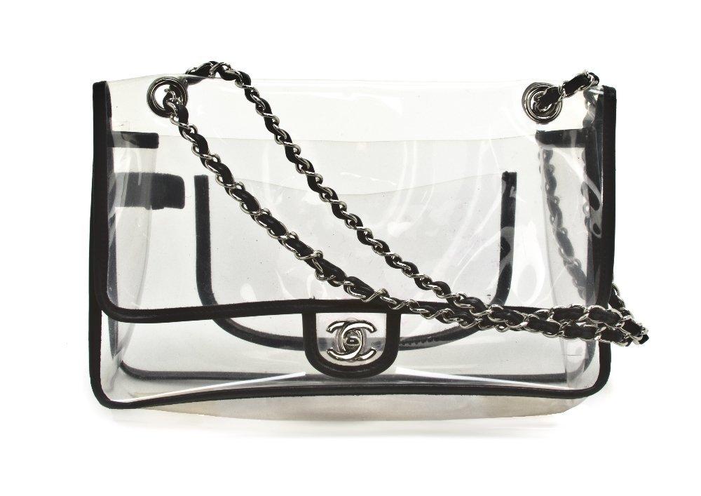 695: A Chanel Clear Vinyl Bag, 11 1/2 x 7 x 2 inches.