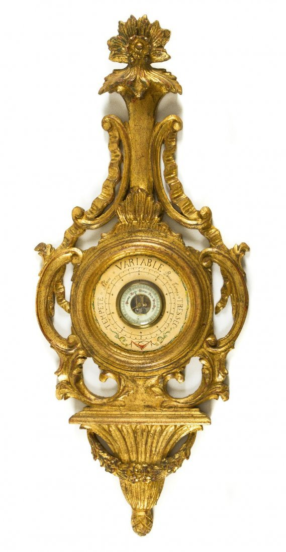 9: A Italian Giltwood Barometer, Height 38 1/2 inches.