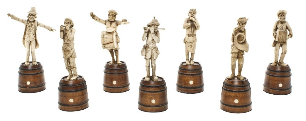 10: A Set of Seven Continental Carved Ivory Figures, He