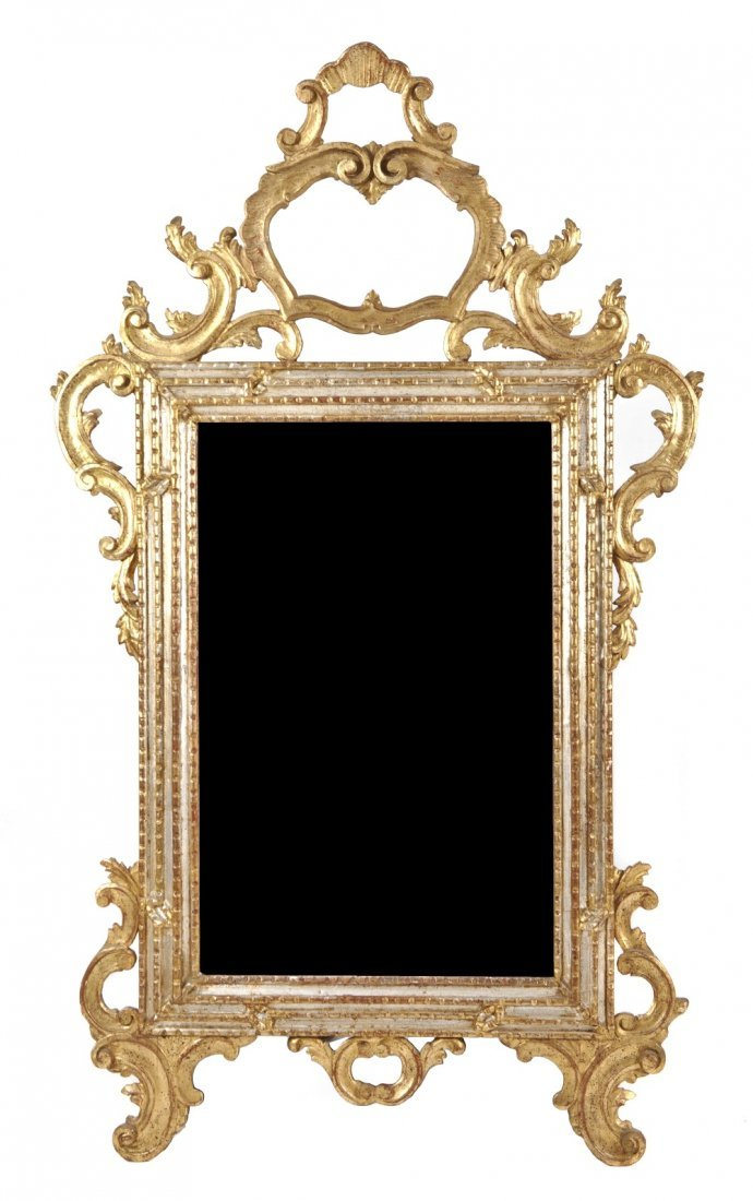 24: A Louis XV Style Parcel Gilt and Silvered Mirror, H