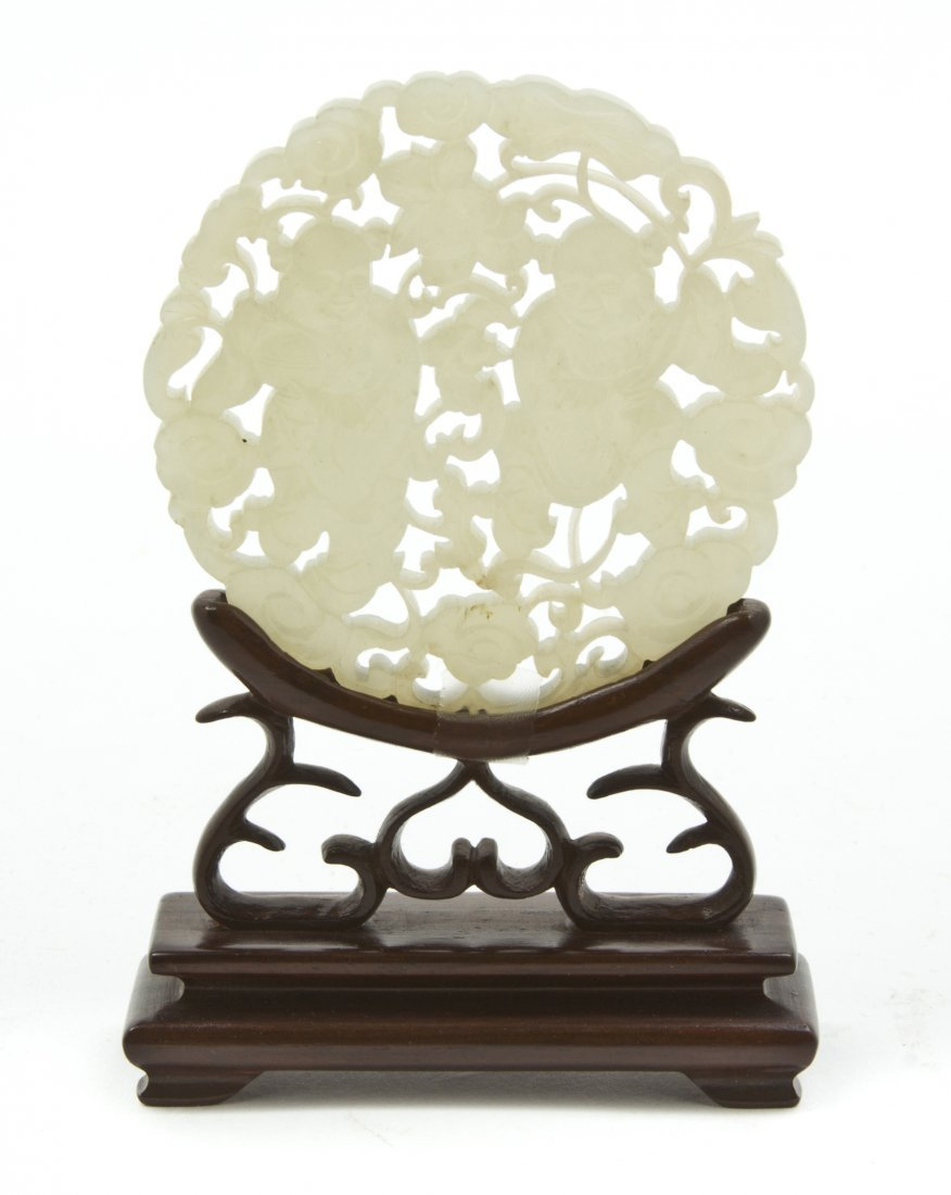 2548: A Chinese Pierce Carved Jade Plaque, Diameter 2 7