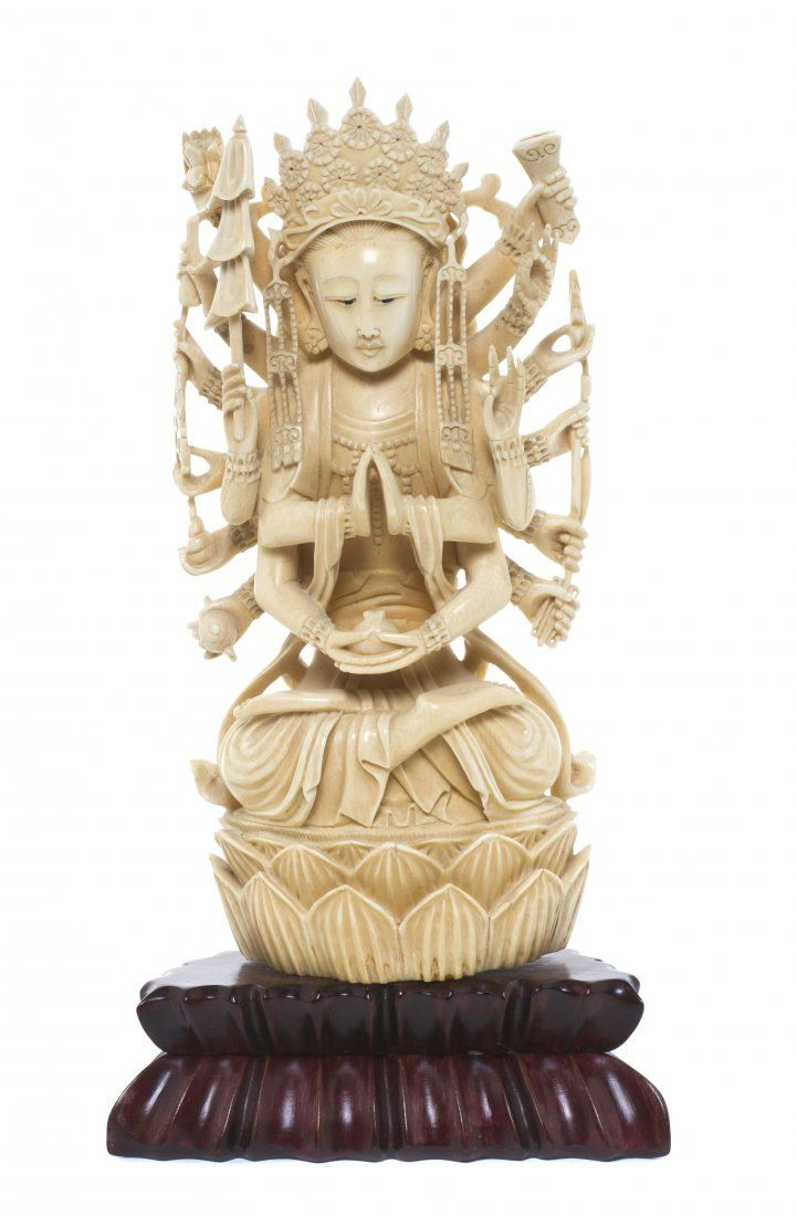 A Carved Ivory Model of a Multi-Armed Deity, Heig