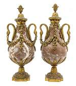 57 A Pair of Neoclassical Rouge Marble and Gilt Bronze