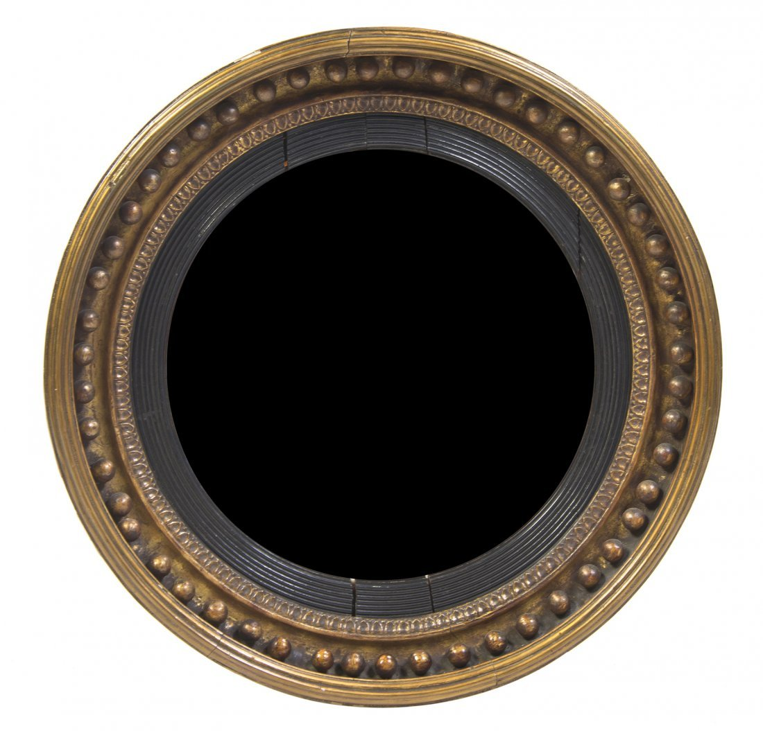 646: An Ebonized and Parcel Gilt Bullseye Mirror, Diame