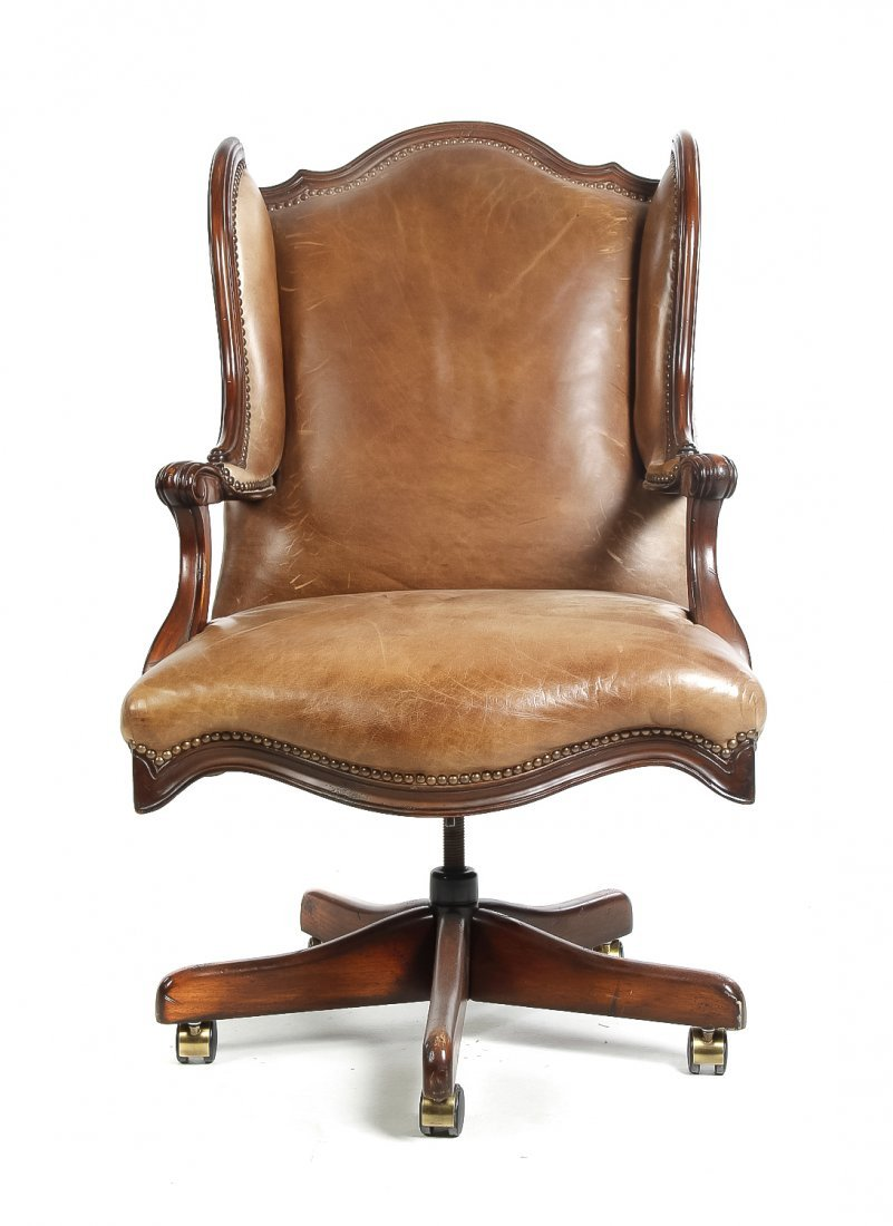 An Upholstered Leather and Mahogany Desk Chair, Height