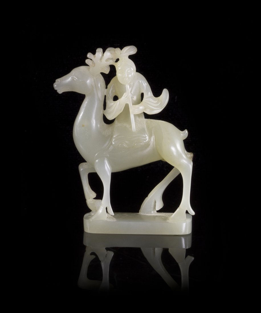 A White Jade Figural Carving, Height 3 inches.