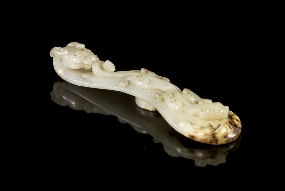 A Carved White Jade Belthook, Length 6 3/8 inches.