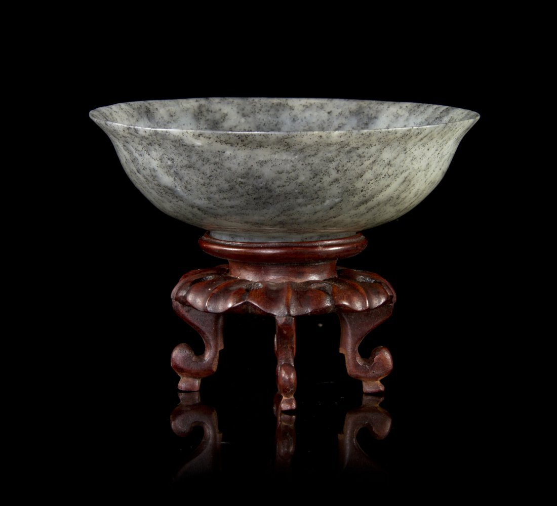 A Carved Grey and White Jade Bowl, Diameter 5 1/8 inche