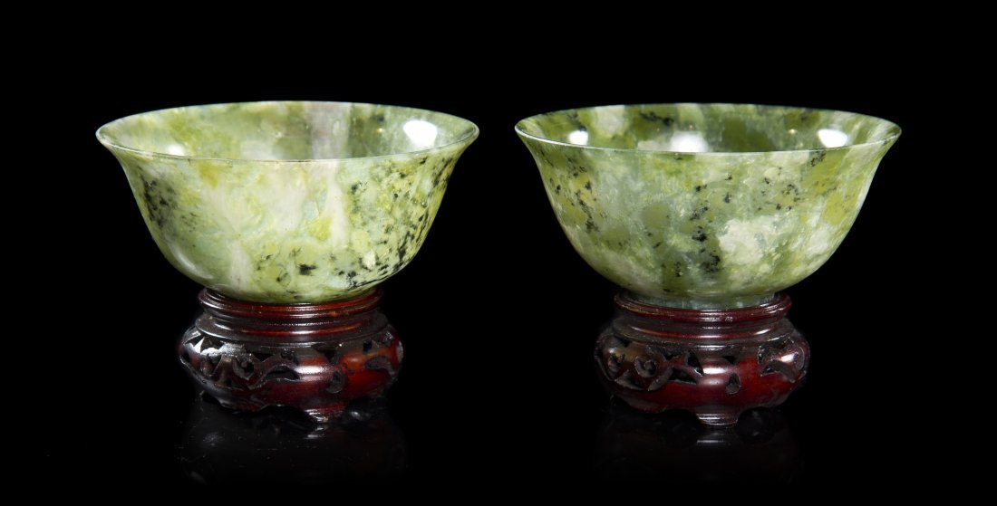 A Pair of Carved Jade Bowls, Height 4 inches.