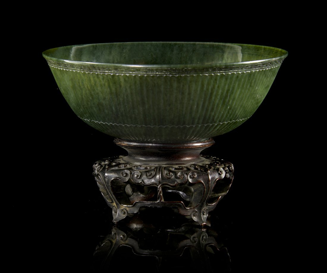 A Mughal Style Carved Jade Bowl, Diameter 6 1/2 inches.