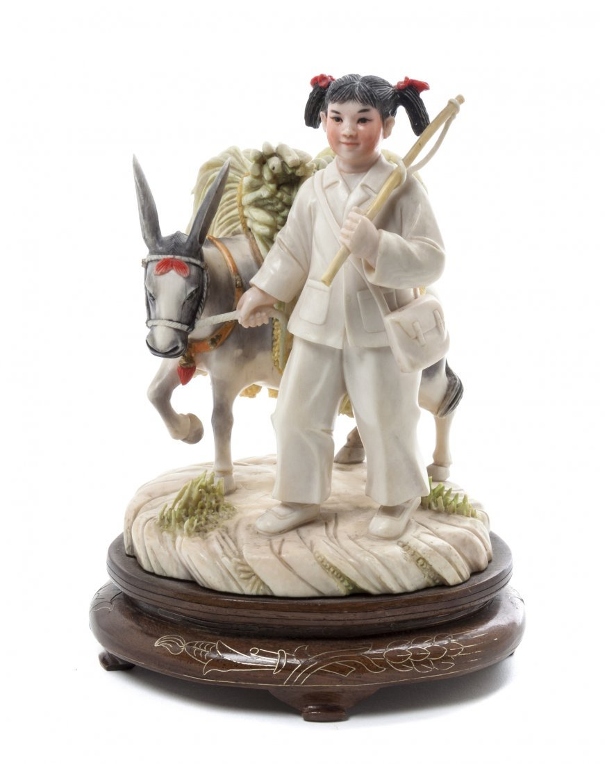 A Carved Ivory Figure of a Girl and Donkey, Height 5 5/