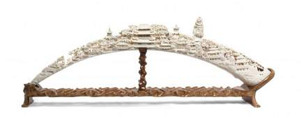 A Chinese Carved Ivory Tusk, Length 37 1/8 inches.