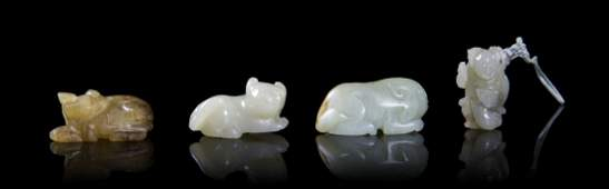 A Group of Four Chinese Carved Jade Toggles, Length of