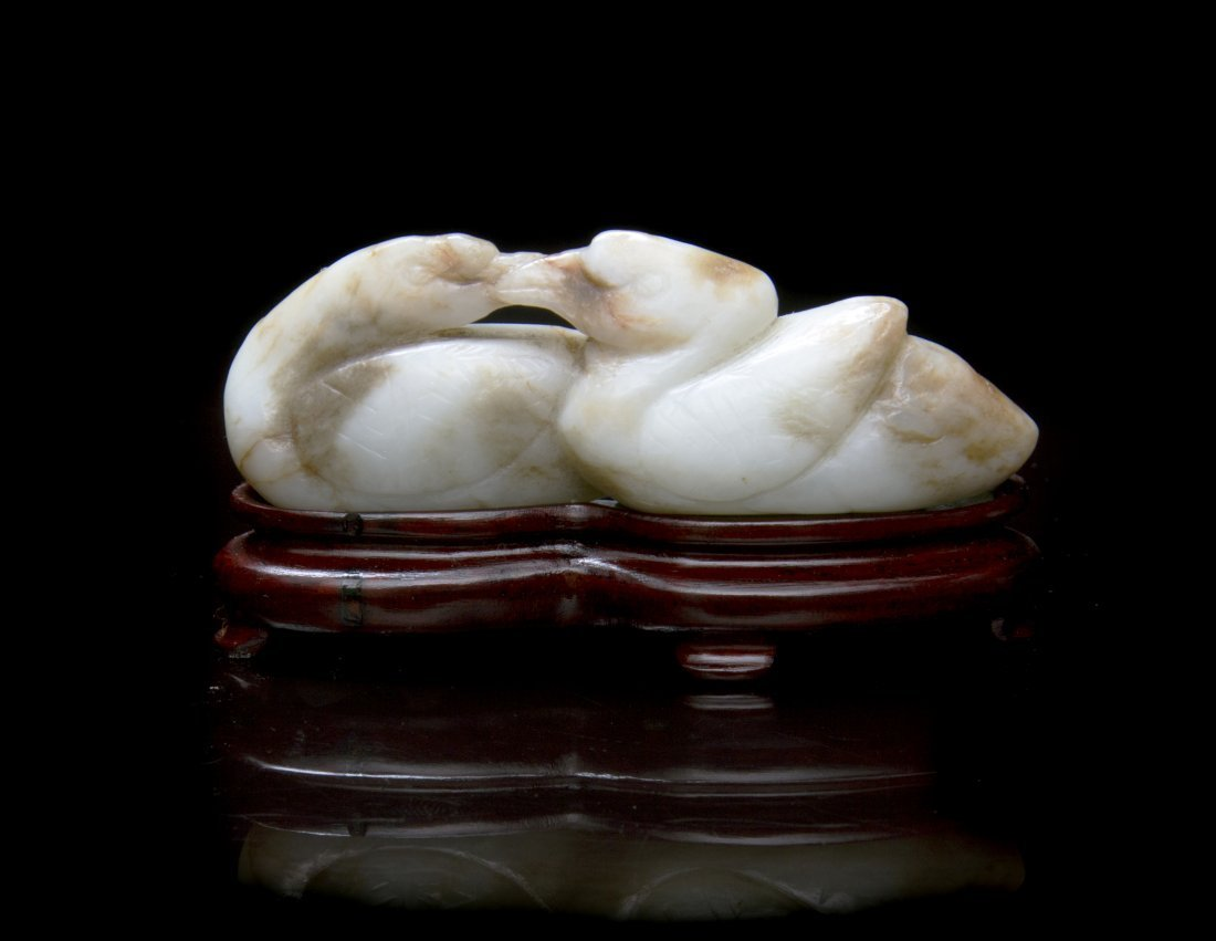 A Carved Jade Toggle of Two Ducks, Width 3 inches.