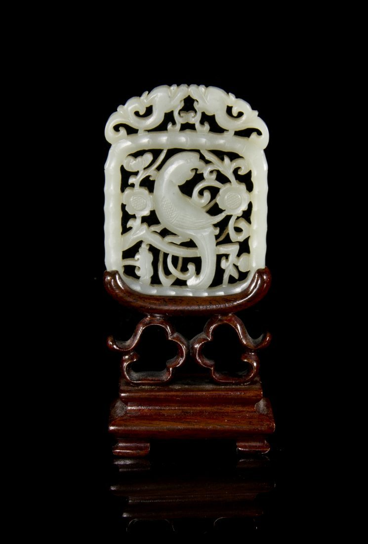 A Pierce Carved Jade Plaque, Height 2 1/2 inches.