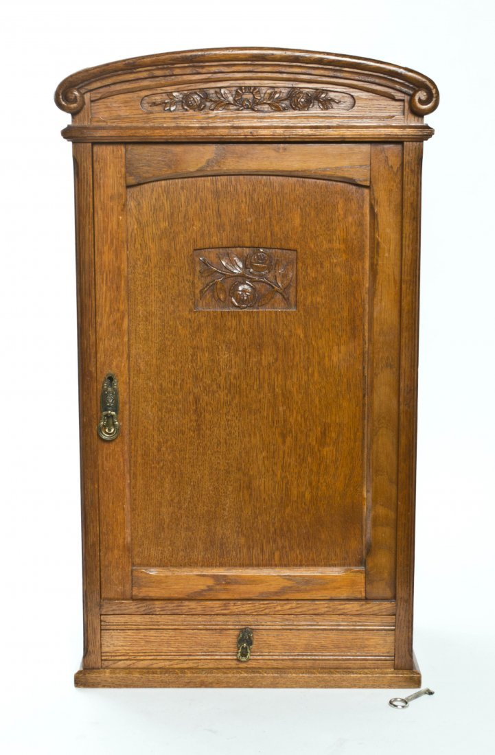 An Art Nouveau Style Oak Cabinet, Height 29 1/2 inches.
