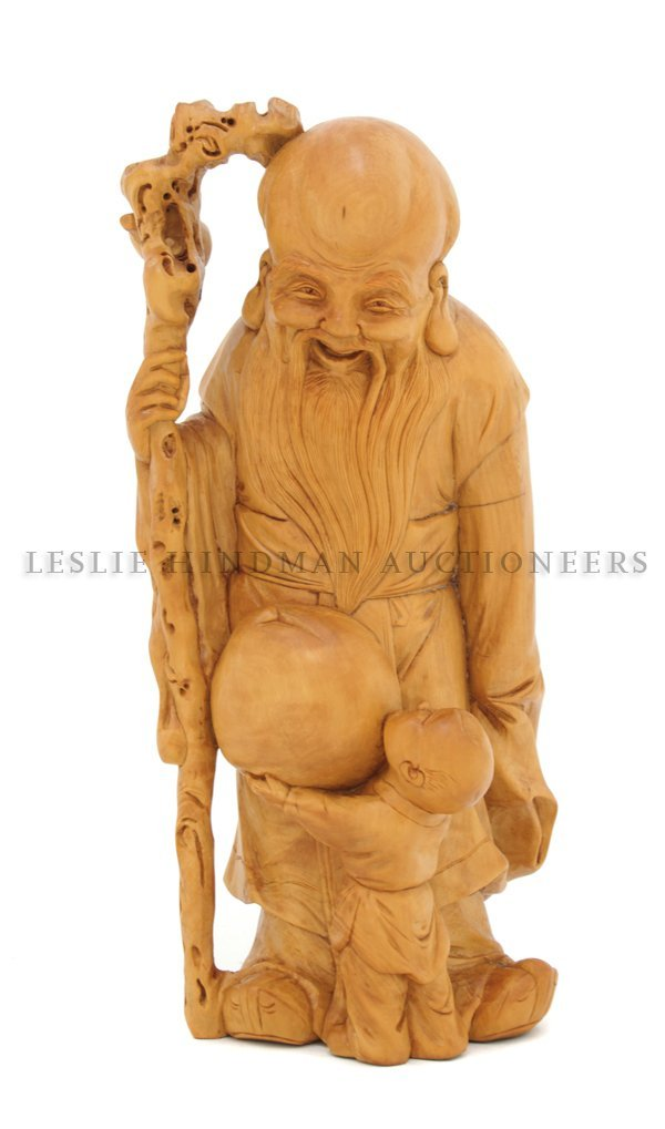 A Carved Boxwood God of Longevity Figure, Height 10 inc
