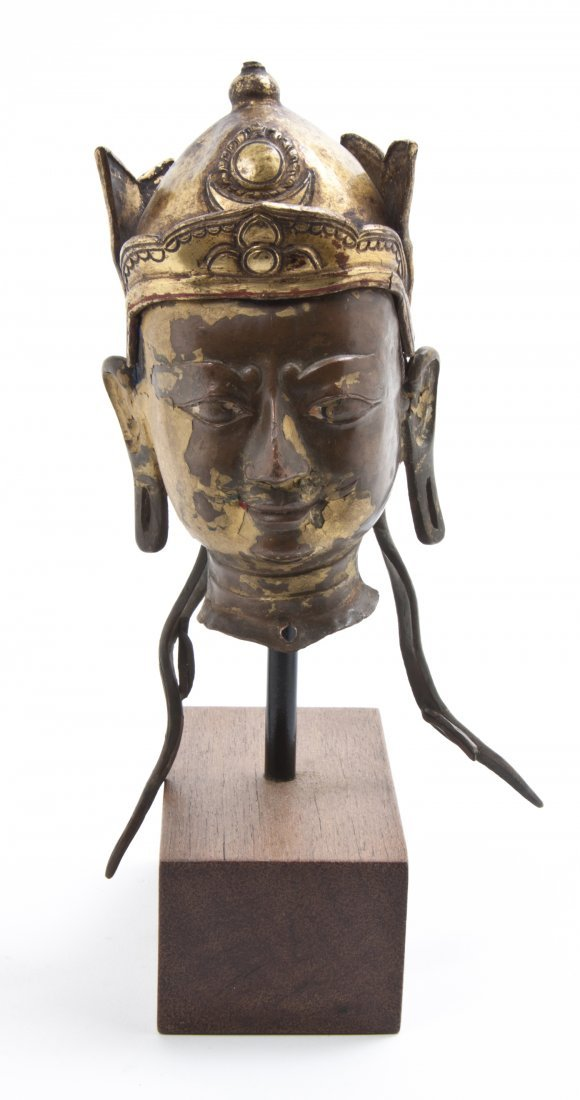 A Bronze Head of Buddha, Height 5 1/2 inches.