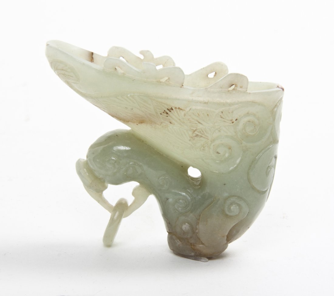 A Chinese Carved Jade Libation Cup, Width 2 3/4 inches.