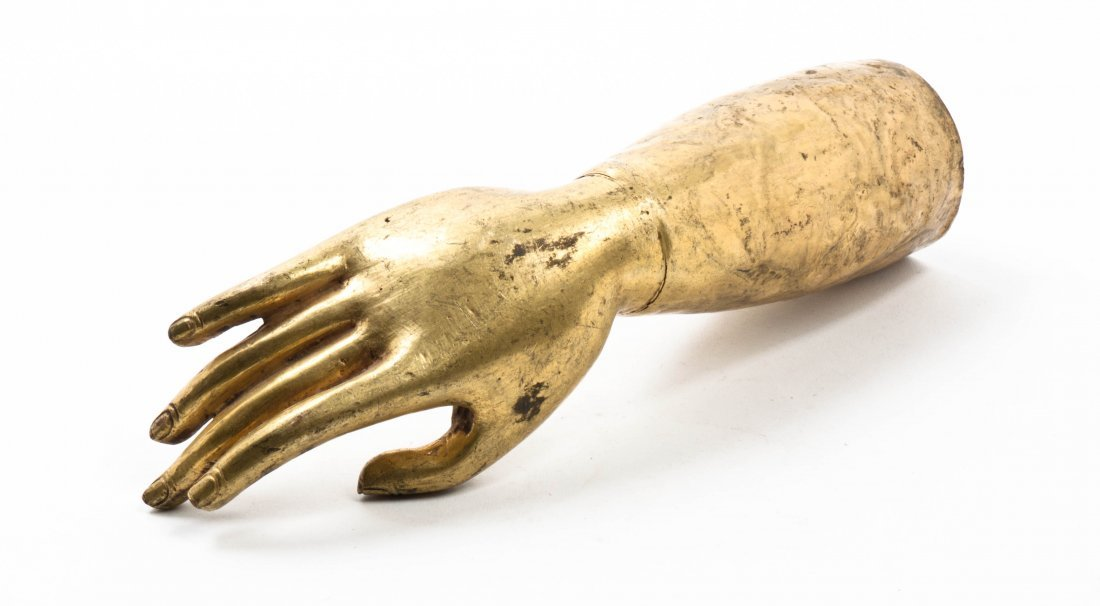 A Gilt Bronze Model of a Hand. Length 11 3/8 inches.
