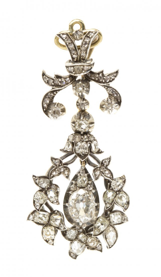 A Victorian Silver Topped Gold and Diamond Pendant, 4.9