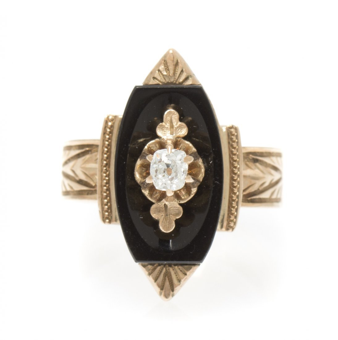 A Victorian Yellow Gold, Onyx and Diamond Ring, 2.80 dw