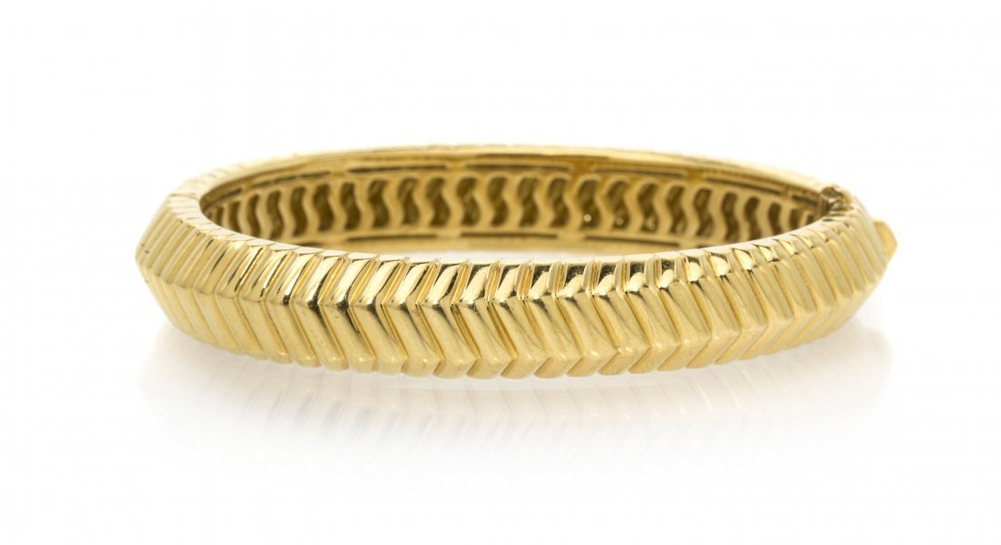 An 18 Karat Yellow Gold Bangle Bracelet, Tiffany & Co.,