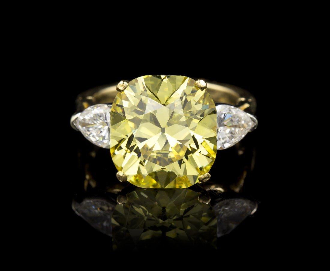 An 18 Karat Yellow Gold, Fancy Vivid Yellow Diamond and