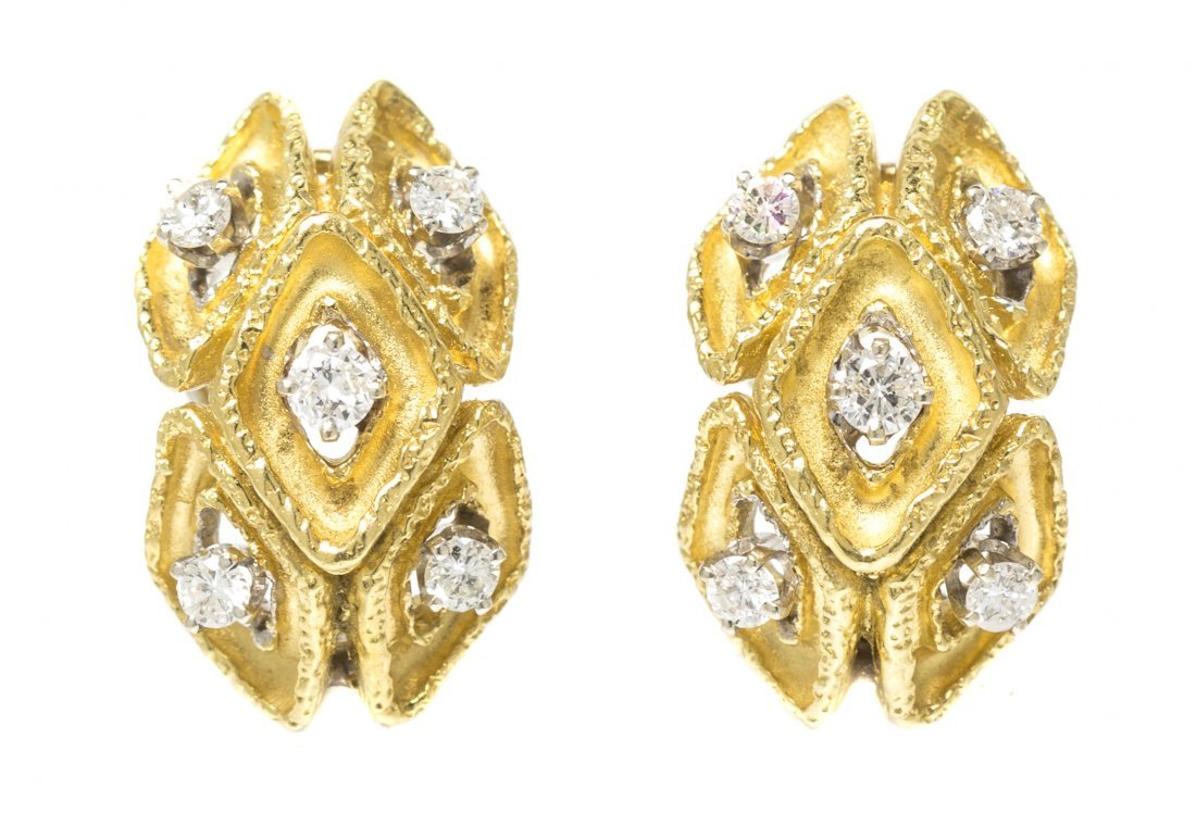 A Pair of 18 Karat Yellow Gold and Diamond Earclips, 9.
