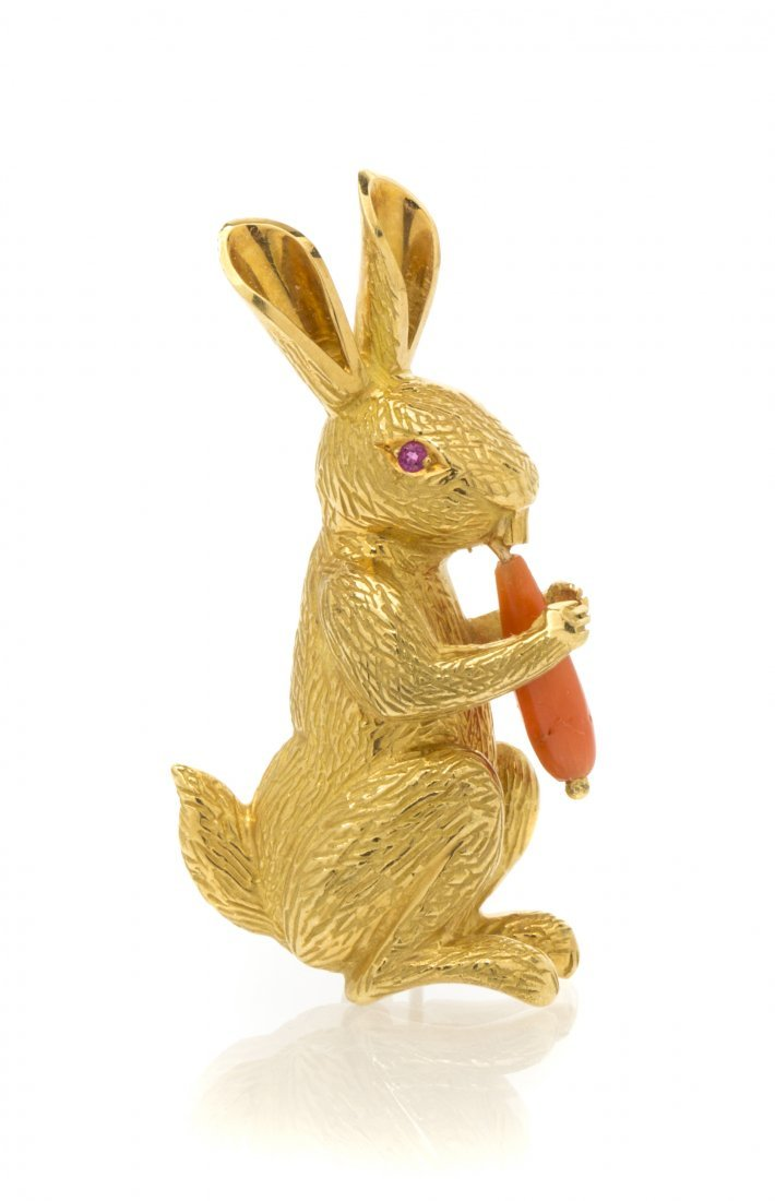 An 18 Karat Yellow Gold, Coral and Ruby Rabbit Brooch,
