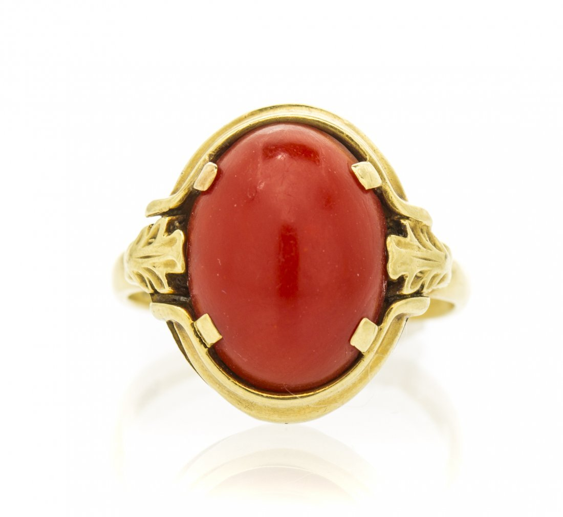 A 14 Karat Yellow Gold and Coral Ring, 2.70 dwts.