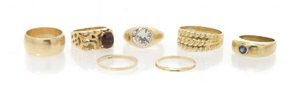 A Collection of 14 Karat Yellow Gold and Gem Rings 32