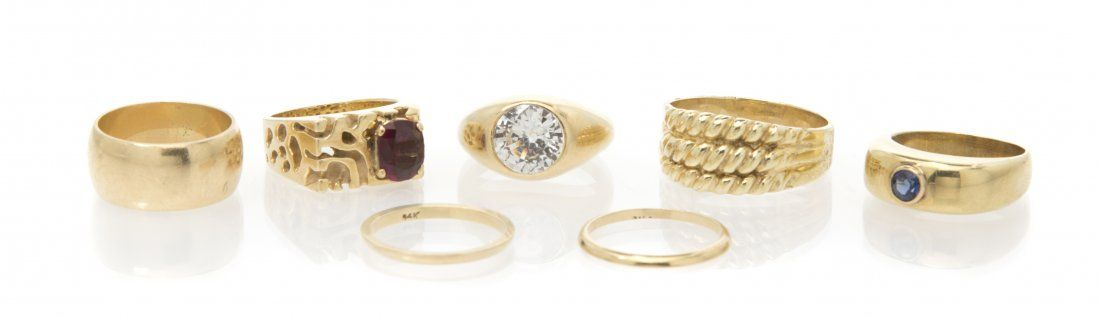 A Collection of 14 Karat Yellow Gold and Gem Rings, 32.