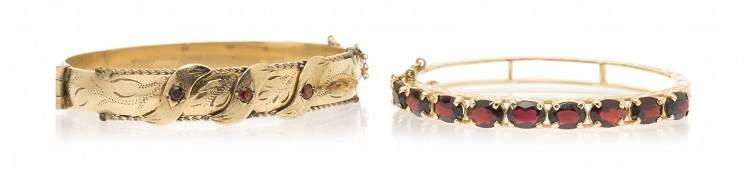A Collection of 14 Karat Yellow Gold and Garnet Bangle
