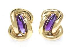 A Pair of 14 Karat Yellow Gold and Amethyst Earclips 1