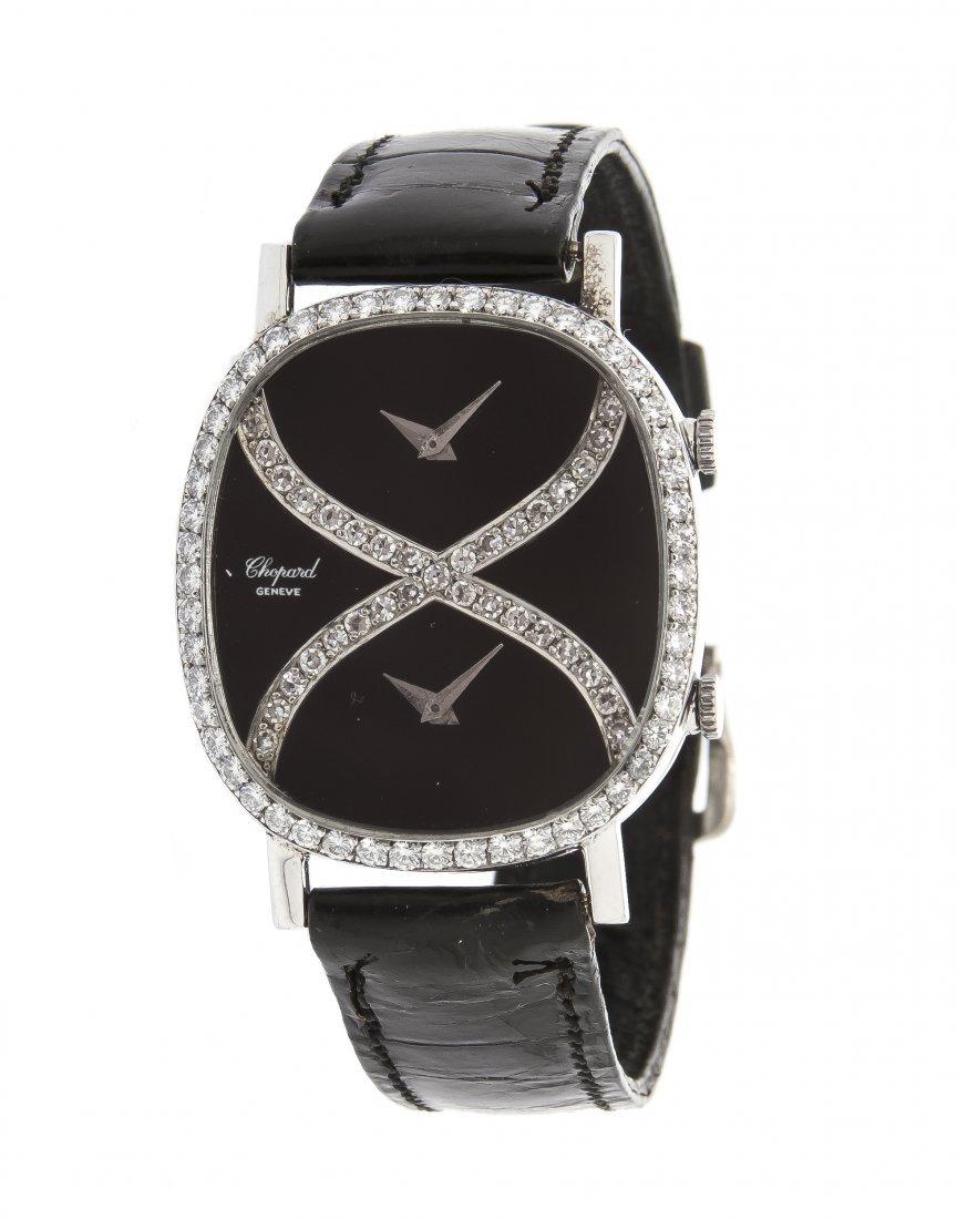 An 18 Karat White Gold and Diamond Dual Timezone Wristw